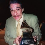 Dave Valentin displays his Grammy Award, Seuffert Bandshell, Woodhaven, Queens, New York. June 16, 2003, photo by Jerry Lacay.