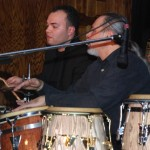 Jotan Afanador, drum set, Angel Rodriguez, conga drums, Mike Zarirfis, alto saxophone, Stathakion Cultural Center, Astoria, Queens, New York, November 4, 2007.
