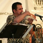 Demetrios Kastaris plays a large conch shell, Seuffert Bandshell, Woodhaven, Queens, New York, June 16, 2003. Photo by Jerry Lacay.