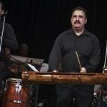 "Demetrios plays the typical ""Guagua"" on an Afro-Cuban Rumba Guaguancó at the Katharí Debut concert at the Katharí, Record Release Concert at the Langston Hughes Community Library and Cultural Center in Corona Queens, New York, November 2, 1013, photo by Norm Harris."