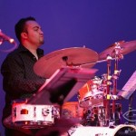 Jotan Afanador. While only 21 years of age, son of  a Christian pastor Jotan Afandador won the title of world's fastest drummer, performing an amazing 1123 single strokes in 60 seconds! Playing here with Demetrios in the Queens Theatre in the Park.