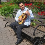 Sam Martinez at a park near his home in Manhattan playing the Puerto Rican Cuatro. June 2014, photo by Demetrios Kastaris.