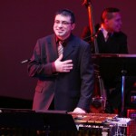 Christos Rafalides vibraphonist, Queens Theatre in the Park, Flushing, New York, December 17, 2004, photo by Jerry Lacay. (Bass player in background is Solo Rodriguez).