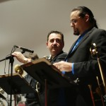 Demetrios Kastaris reviews music with Steve Turre just before the concert, Queens Theatre in the Park, Flushing, New York, December 17, 2004, photo by Jerry Lacay.