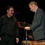Pete McGuinness receives Award for Outstanding Musicianship for his marvelous arrangements and trombone playing from Demetrios Kastaris. Langston Hughes Community Library and Cultural Center in Corona Queens, November 2, 1013, photo by Norm Harris.