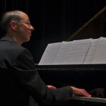 Pianist/ arranger, Joel Weiskopf sits at the grand piano, Katharí Record Release Concert at the Langston Hughes Community Library and Cultural Center in Corona Queens, November 2, 1013, photo by Norm Harris.