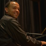 Wesley Reynoso plays the piano at the Langston Hughes Community Library and Cultural Center Saturday, October 18, 2015.