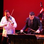 Front row: Alfredo de la Fé, violin, Christos Rafalides, vibraphone, back row left: Edy Martinez, right, Solo Rodriguez, Queens Theatre in the Park, Flushing, New York, December 17, 2004, photo by Jerry Lacay.