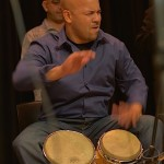 Bongo drum player Ramon Tineo performing at the Langston Hughes Community Library and Cultural Center Saturday, October 18, 2015.