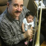 Demetrios playing trombone with his granddaughter, Carmen, December 2015