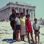 The Kastaris family visits Athens, Greece after seven years in the United States. Photo taken at the Acropolis, Athens, Greece. Acros-point of, polis-city, Acropolis- city on the point of a mountain.