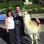 Hilda and Demetrios posing with a llama in Bogotá, Colombia, South America.