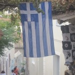 Greek Flag, displayed on a pathway, walking up to the Acropolis. photo credit Demetrios Kastaris, September, 2014.